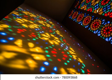 SHAKI, AZERBAIJAN - 3 JUNE 2017. Sunlight through the stained glass window in the Palace of Shaki Khans, Azerbaijan. Vibrant spots on the wall in a pattern
