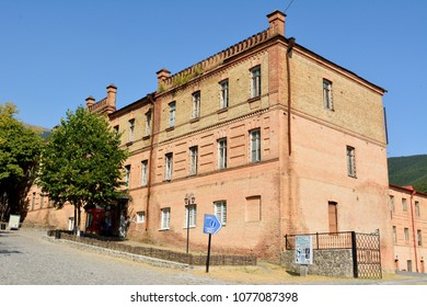Shaki, Azerbaijan - August 13, 2017. Exterior view of historic building of Shaki Crafts House, dating from 1895, in Shaki, Azerbaijan, with commercial properties and people.