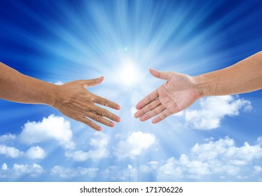 shaking hand with blue sky and sun light background