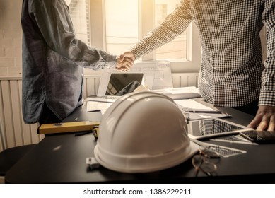 Shaking hand contractor engineer construction meeting business worker.