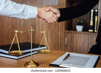 Shaking hands after good cooperation, Business woman handshake female lawyer after discussing good deal of contract, Meeting and collaboration concept.