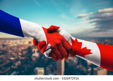 Shaking Hands France and Canada