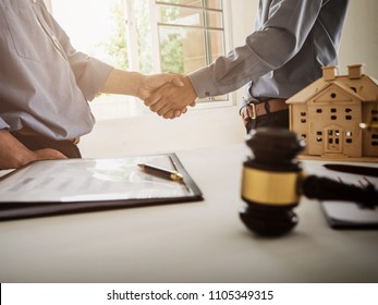Shaking hands partnership tax lawyer and real estate agent for teamwork concept.