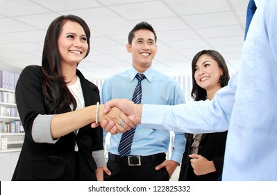 Shaking hands of two business people in the office
