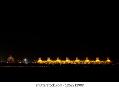 SHAKIR, BAHRAIN - DECEMBER 16: Illuminated VIP tower (Sakhir tower) and Main Grandstand on the occasion of National Day Fireworks at Bahrain International Circuit on December 16, 2018 during night