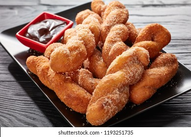 Shakoy or pilipit - deep fried twisted donuts, Filipino favorite dessert and a popular street food in the Philippines, the same twisted bread stick also known in the korea  as a Kkwabaegi, close-up