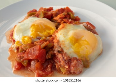 Shakshouka, a popular Middle Eastern dish originating in Tunisia, made of onion, tomato, capsicum, garlic and eggs fried together with the egg added last.