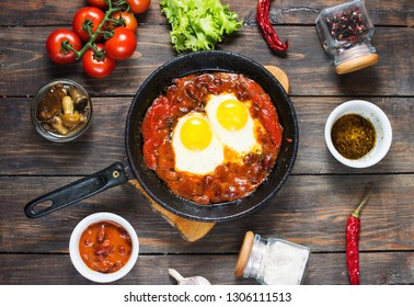 Shakshuka, Fried Eggs in Tomato Sauce in iron frying pan. Typical Israel food.