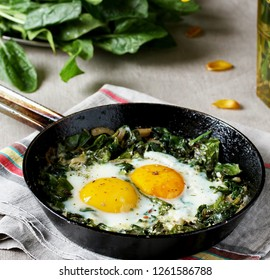 shakshuka with spinach or fried eggs. Green Shakshuka. Cook in Israel. Paleo. Keto diet dish. square format