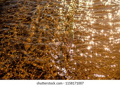 shalllow water of the sea with sun reflections