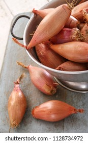 shallot onions in colander