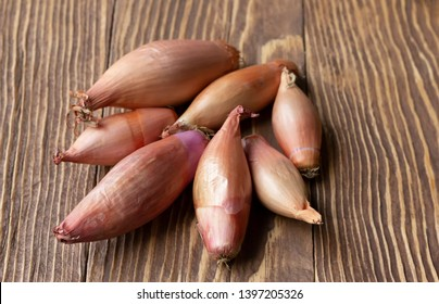 Shallot onions on a wooden background