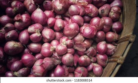 Shallots. Fresh purple shallots on bamboo basket.  Shallots close up.