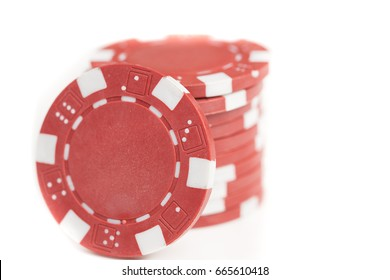 Shallow depth of field close up of a pile of red gaming chips