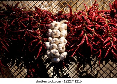 Shallow depth of field of the famous red sweet and chili Hungarian paprika hanged up for drying after harvesting. Traditional Hungarian food souvenirs