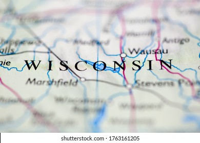 Shallow depth of field focus on geographical map location of Wisconsin United States of America USA continent on atlas