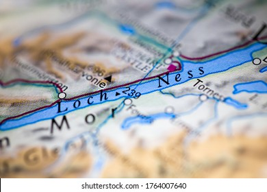Shallow depth of field focus on geographical map location of Loch Ness Scotland United Kingdom Great Britain Europe continent on atlas