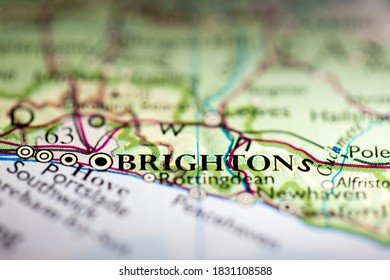 Shallow depth of field focus on geographical map location of Brighton city England United Kingdom Great Britain Europe continent on atlas