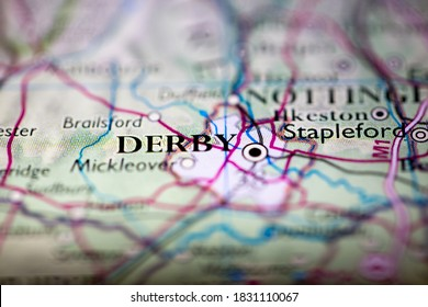 Shallow depth of field focus on geographical map location of Derby city England United Kingdom Great Britain Europe continent on atlas