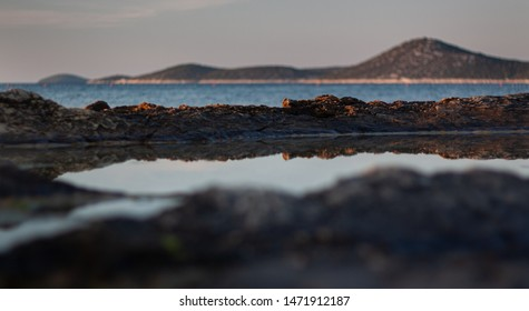 Shallow depth of field landscape shot from a the rocky beach in Vodice Croatia.