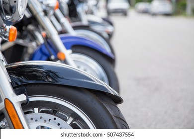 shallow depth of field on a row of motorcycles lined up on the street at the Lucan Baconfest