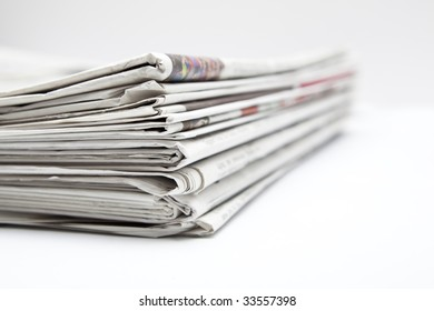 Shallow depth of field from a pile of newspapers