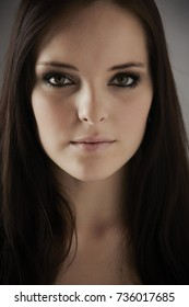 Shallow Depth of Field Portrait of a young adult caucasian woman with dark hair and green eyes (extremely shallow Depth of field)