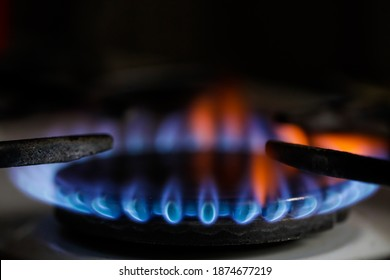 Shallow depth of field (selective focus) image with a burning old traditional gas stove top.