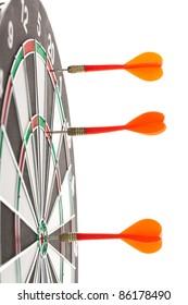 Shallow depth of field shot of darts in bullseye on dartboard