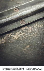 Shallow DOF. Background. Worn out wooden surface with metal details.