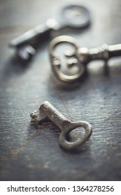 Shallow DOF. Set of antique worn out keys on a wooden background.