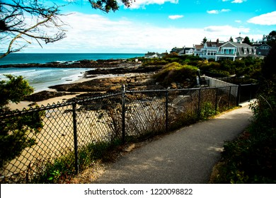 a shallow focus shot of the Marginal Way Path overlooking the rocky coastline in Ogunquit, Maine.  The Path is a very scenic and popular tourist destination.