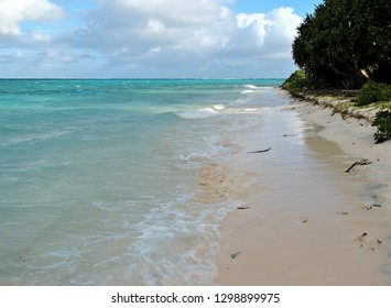 Shallow sandy beach along the tropical waters of the lagoon surrounding this remote tropical island in the Kingdom of Tonga in the south pacific