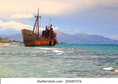 Shallow water and rust covered shipwreck, Gythio, Greece