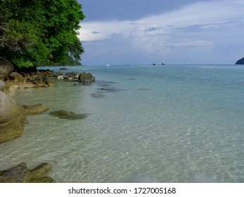 Shallow water view in front of the beach - Shutterstock ID 1727005168