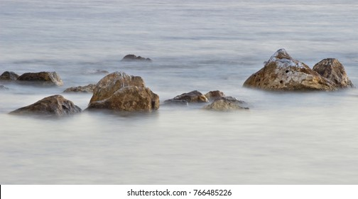 shallows on the Mediterranean coast with the shutter at low speed,peace, calm, serenity, harmony, fullness, well-being, nature, natural, contemplate, meditate, breathe, grow, happiness, tranquility,