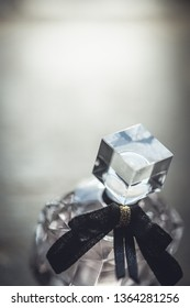 Shalow DOF. A diamond shaped backlit perfume bottle with black bow