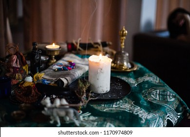 shamanic table. candles and herbs for rituals. close-up of religious accessories. fit for rituals, esoteric. shamanic attributes