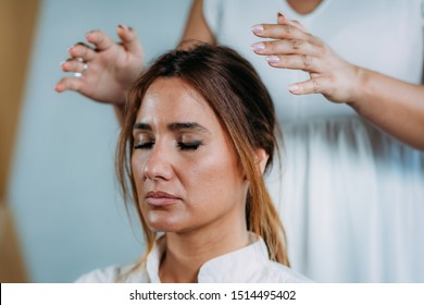 Shamballa Therapist Performing Treatment Holding Hands Over Woman's Head