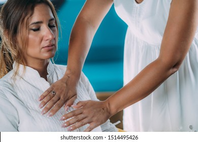 Shambhala Therapist Holding Hands Over Chest of the Patient, Transferring Energy