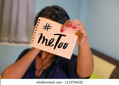 Shamed woman showing page with hashtag #metoo