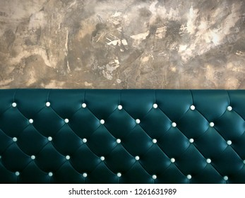 shameless beautiful vintage dark leather cushion sofa, background of white buttoned on luxury blue leather pattern and concrete wall, Vip luxury blue leather with cement wall, loft style background
