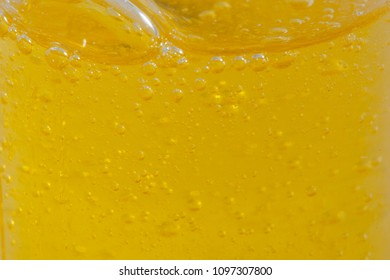 Shampoo closeup - Bubbles on  yellow background