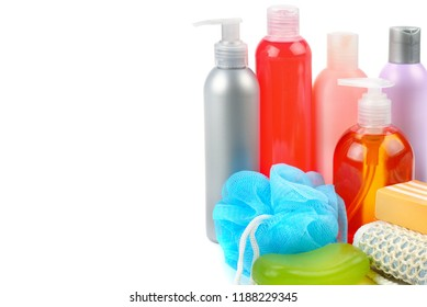 Shampoo, soap and bath sponge isolated on white background. Assortment of personal hygiene items. Free space for text.