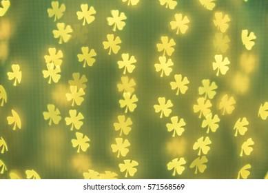 Shamrock bokeh background. Wallpaper, texture and design