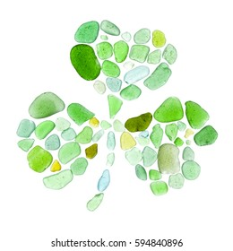 shamrock leaf made of seaglass on white background