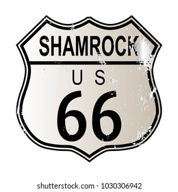 Shamrock Route 66 traffic sign over a white background and the legend ROUTE US 66