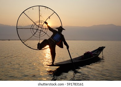 Shan, Myanmar - Feb 16, 2016. Intha people catching fish on Inle Lake in Shan, Myanmar. Inle Lake is a freshwater lake located in the Nyaungshwe Township of Shan State.