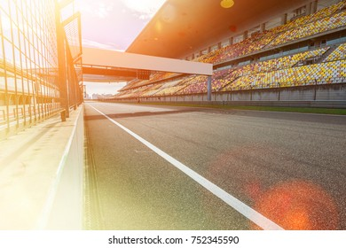 ShangHai, 18 AUG 2017 China: Empty Race track , Formula 1 Circuit with patron grandstand alongside. Concept of spectatorship for decisive sport moments.Empty board above an international racetrack.