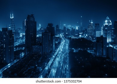 Shanghai aerial night view from above with city skyline and skyscrapers in China.